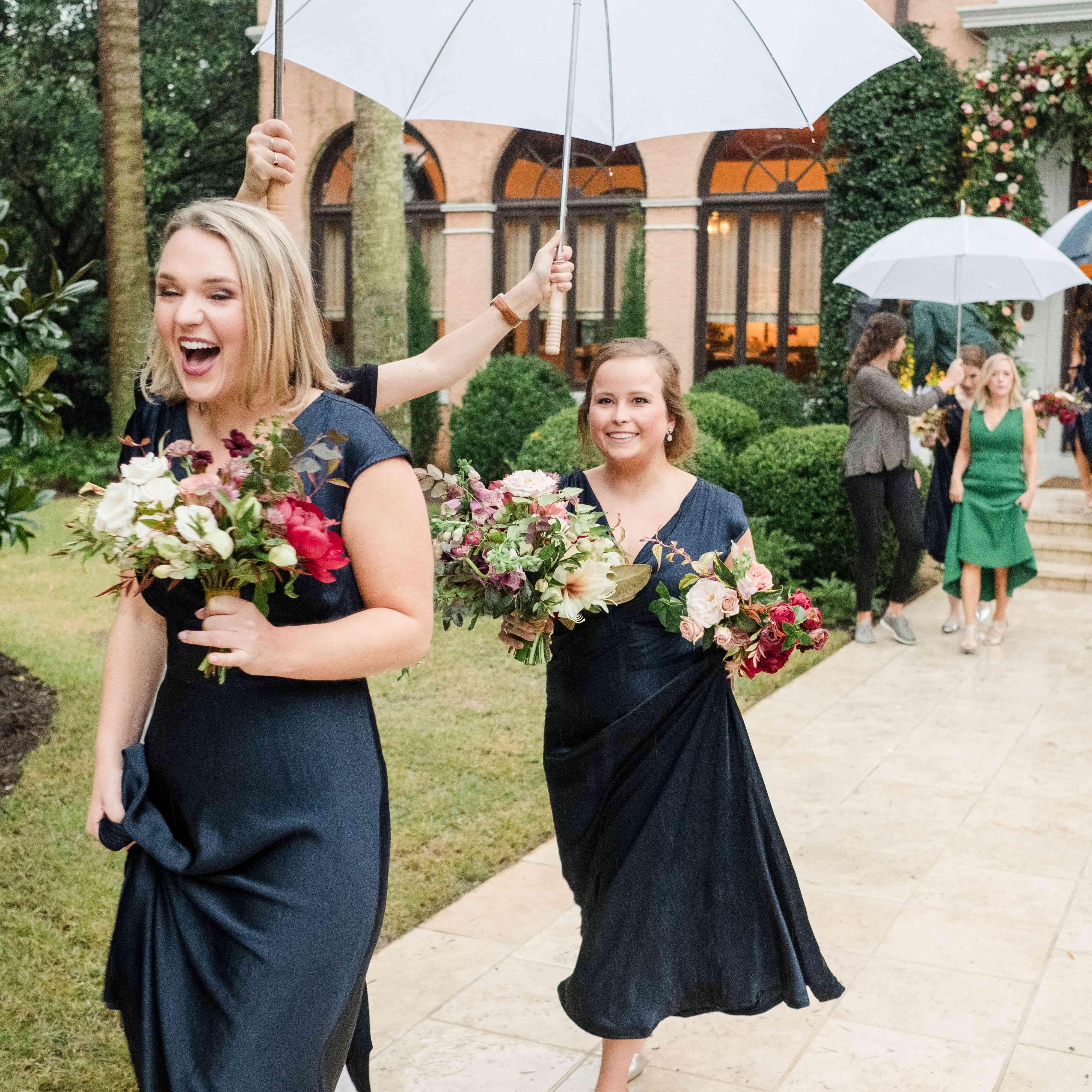 Bridesmaids make their way in the rain