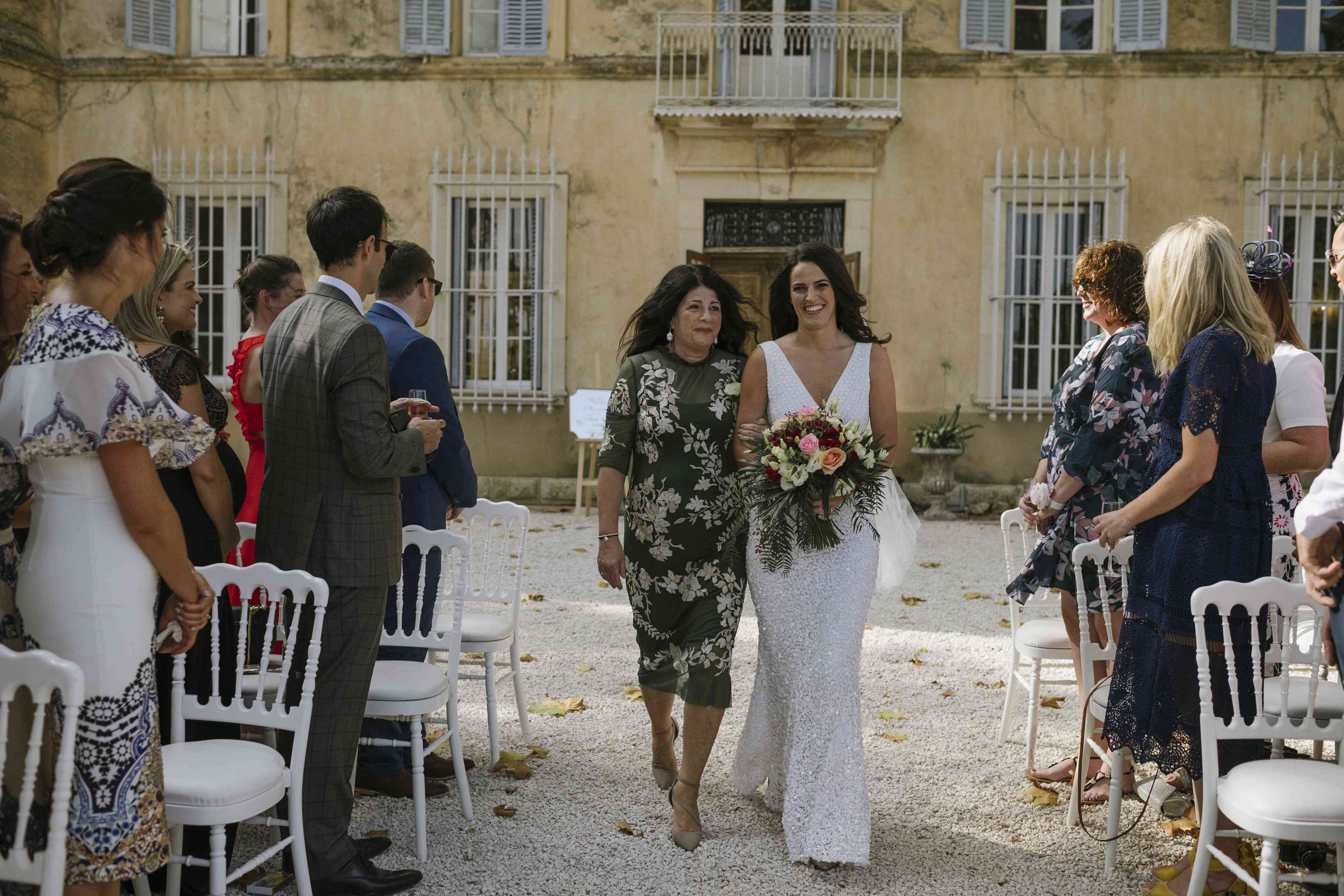 <p>mother of the bride giving away daughter</p><br><br>