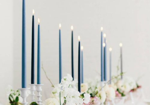 Blue candles at a wedding reception