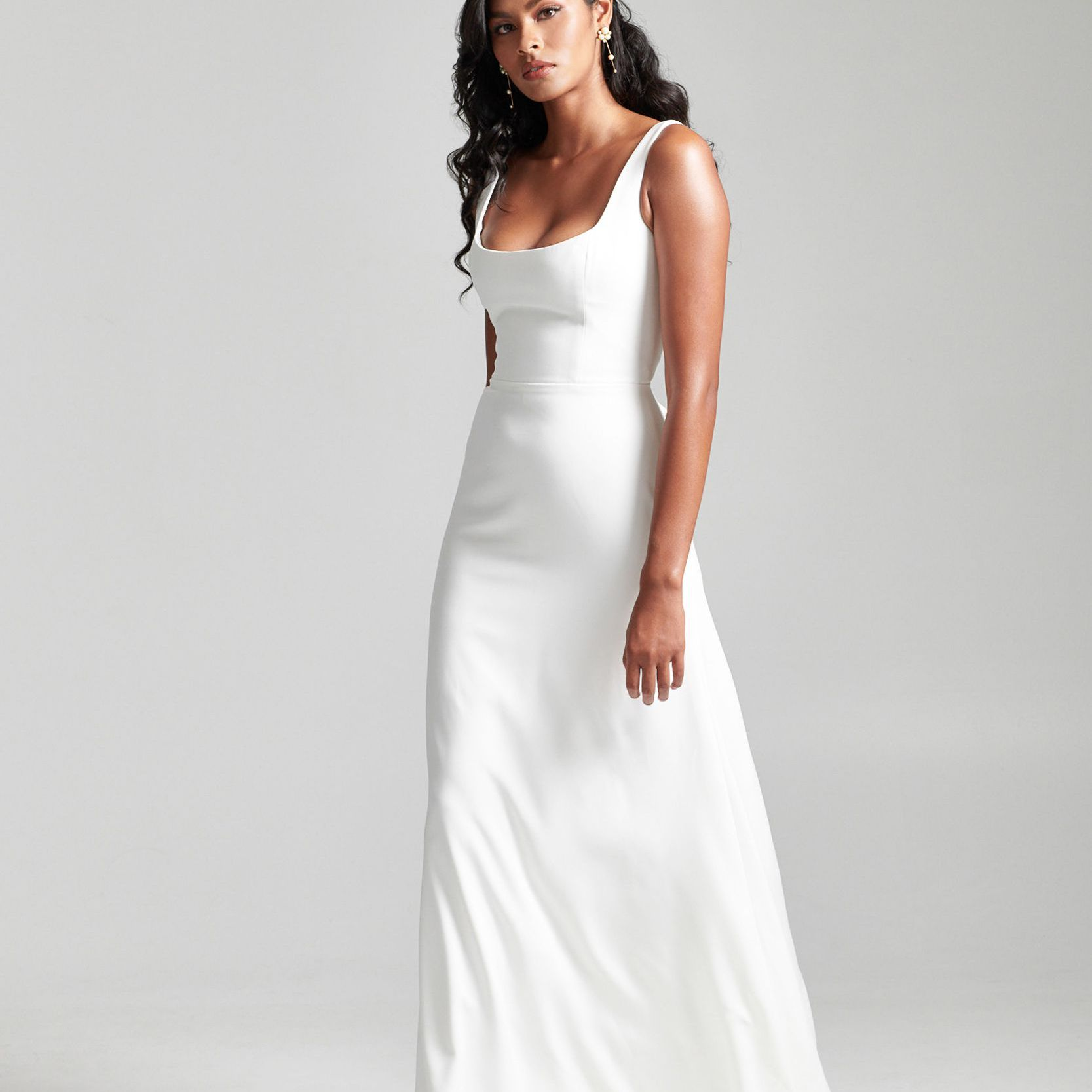 Model in column wedding dress with scoop neck