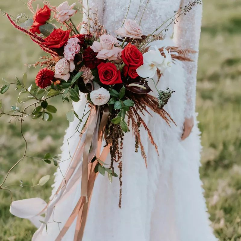 Red, pink, and white wrapped bouquet