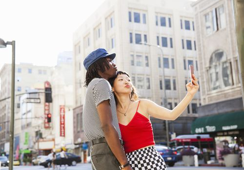 Young couple takes selfie on a street