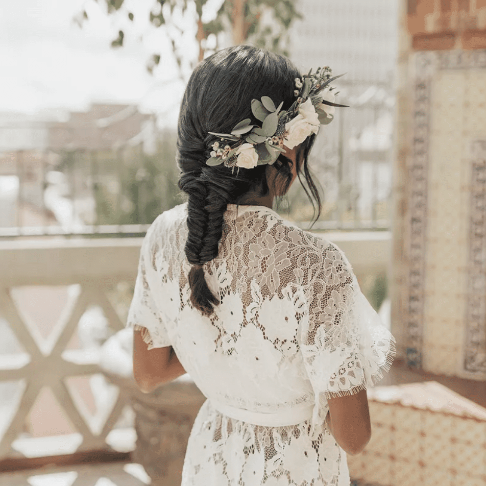 Bride with flower-adorned fishtail braid