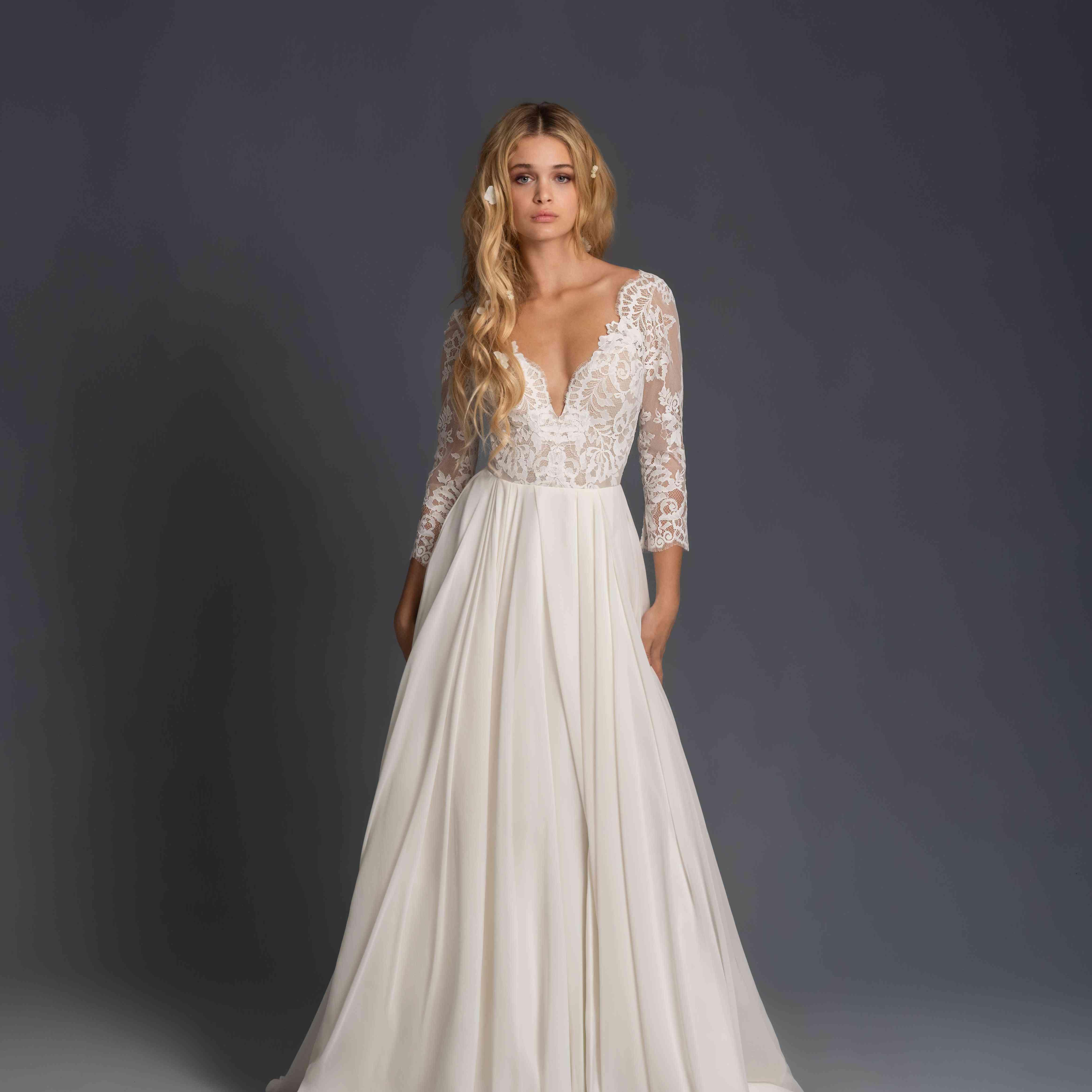 Model in long sleeve plunging wedding dress