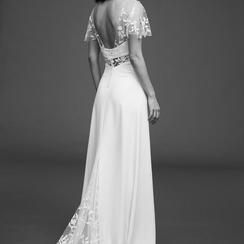 Model in crepe dress with embroidered tulle and butterfly sleeves