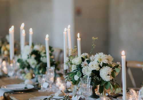 reception tablescape white floral centerpieces and taper candles