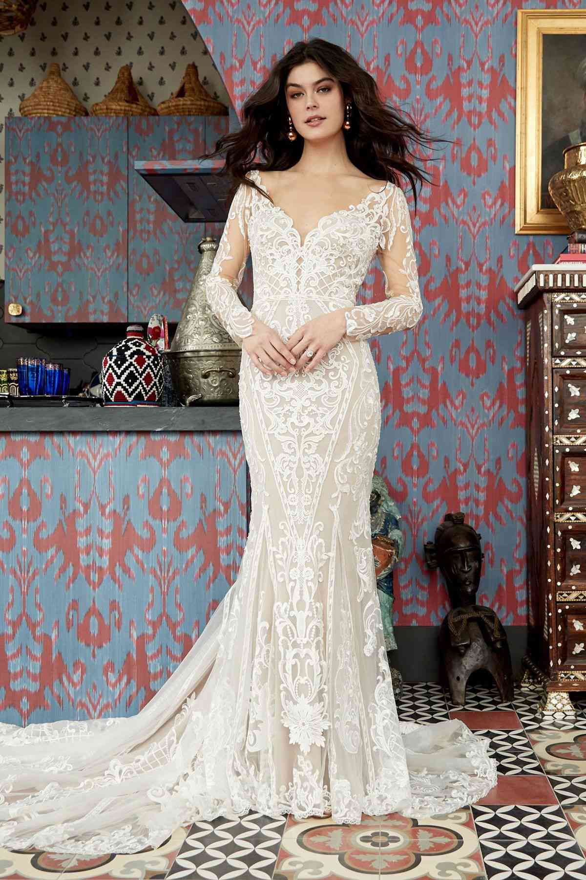 Model in long-sleeve lace fit and flare gown