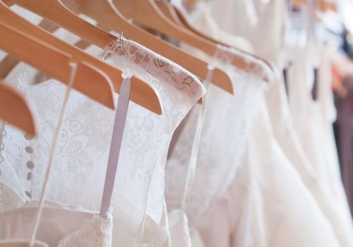 <p>Rack of Wedding Dresses</p>