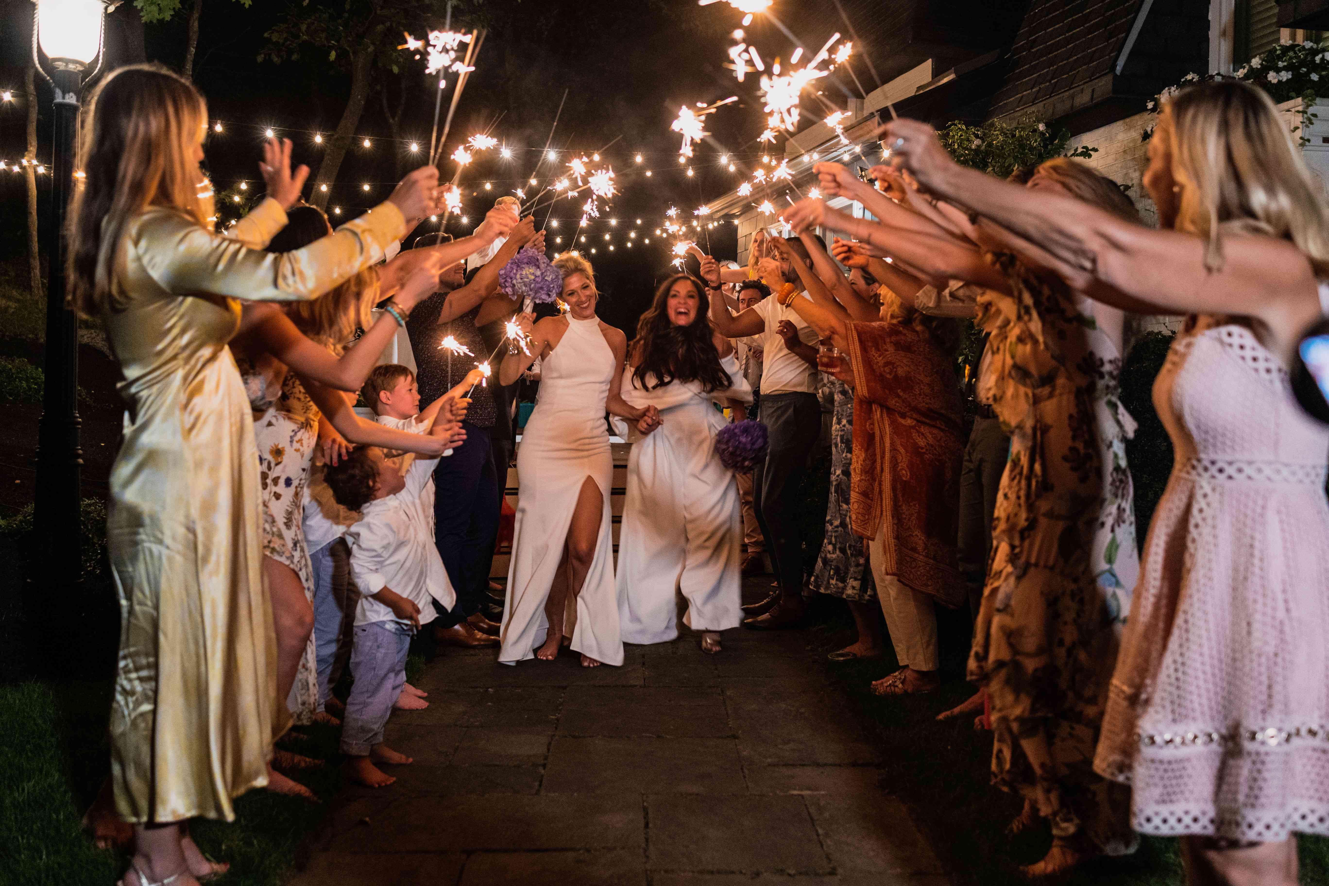 brides under sparklers