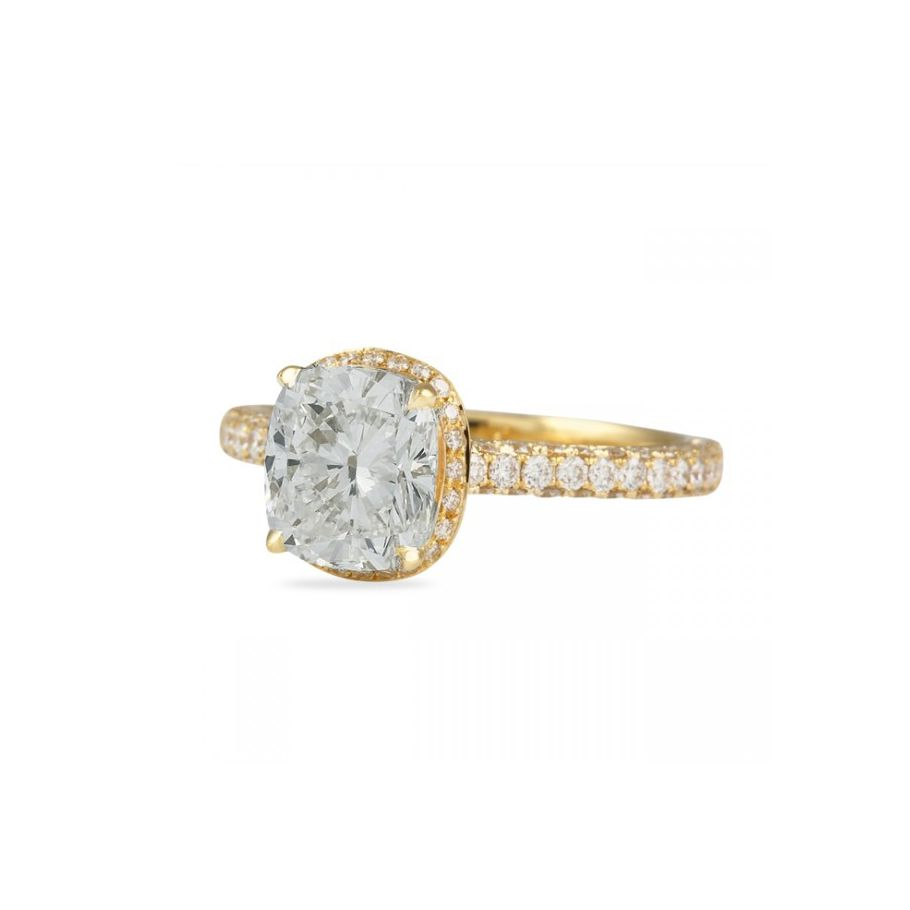 Diamond halo engagement ring with yellow gold eternity band on a white background