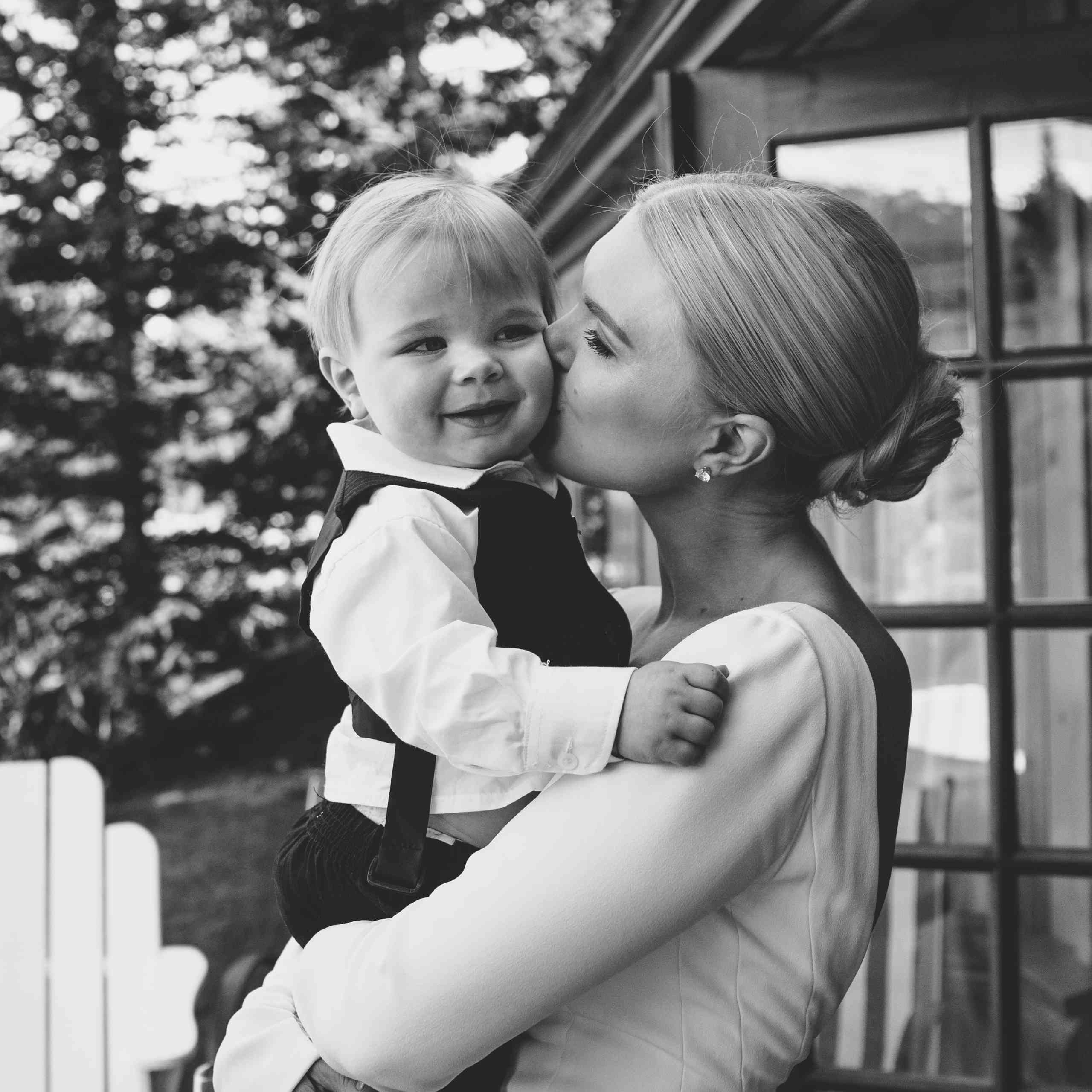 Bride kissing baby