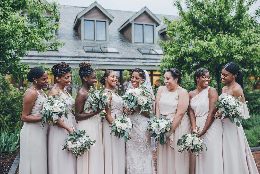 Bridesmaids in beige with bride