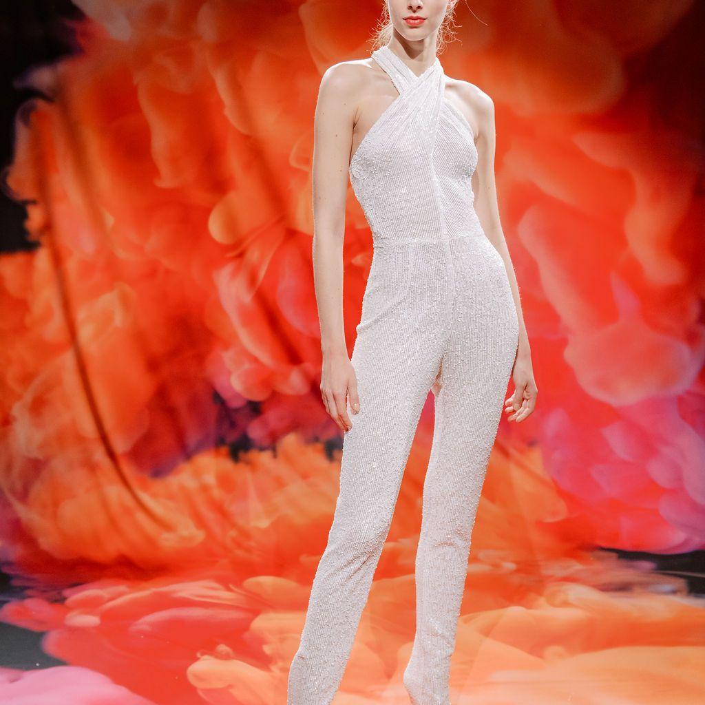 Model in sequined halter-top jumpsuit