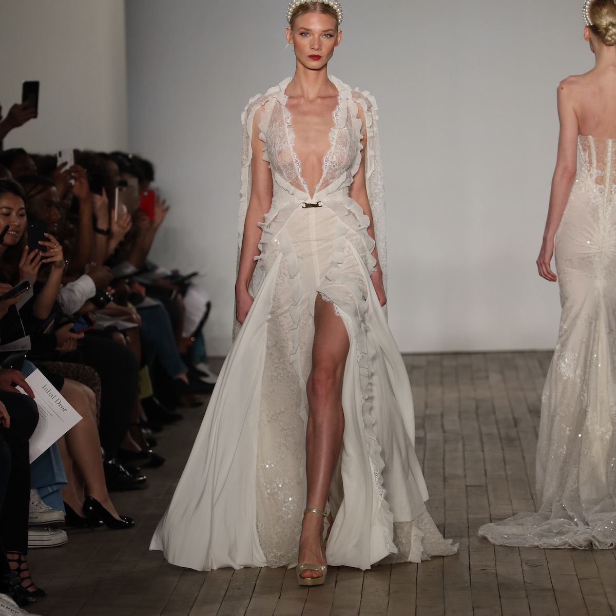 Model in beaded halter wedding dress with cape