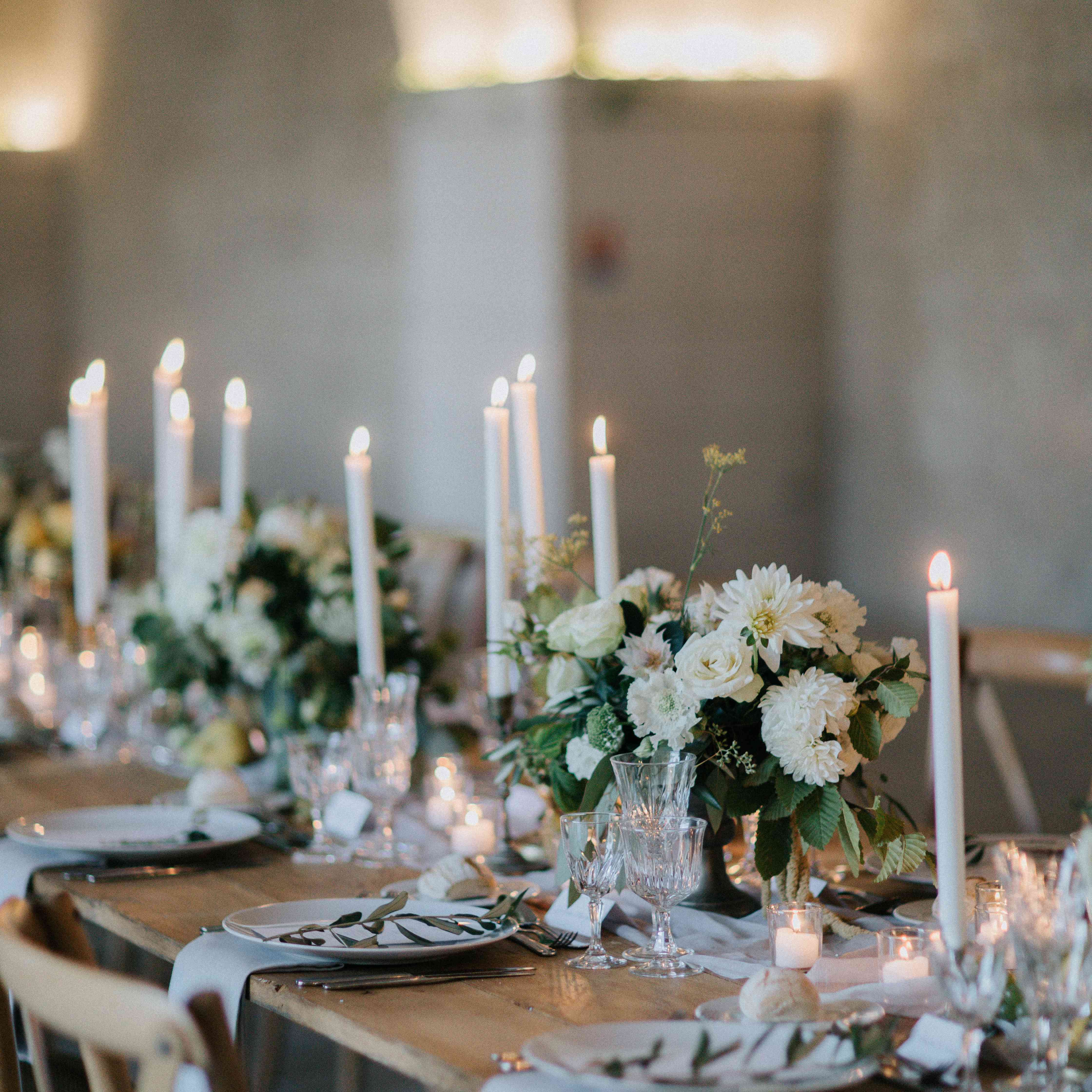 <p>reception tablescape white floral centerpieces and taper candles</p><br><br>