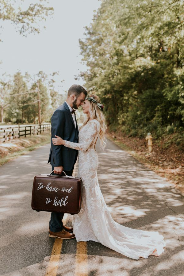 Bride and groom with suitcase photo prop.