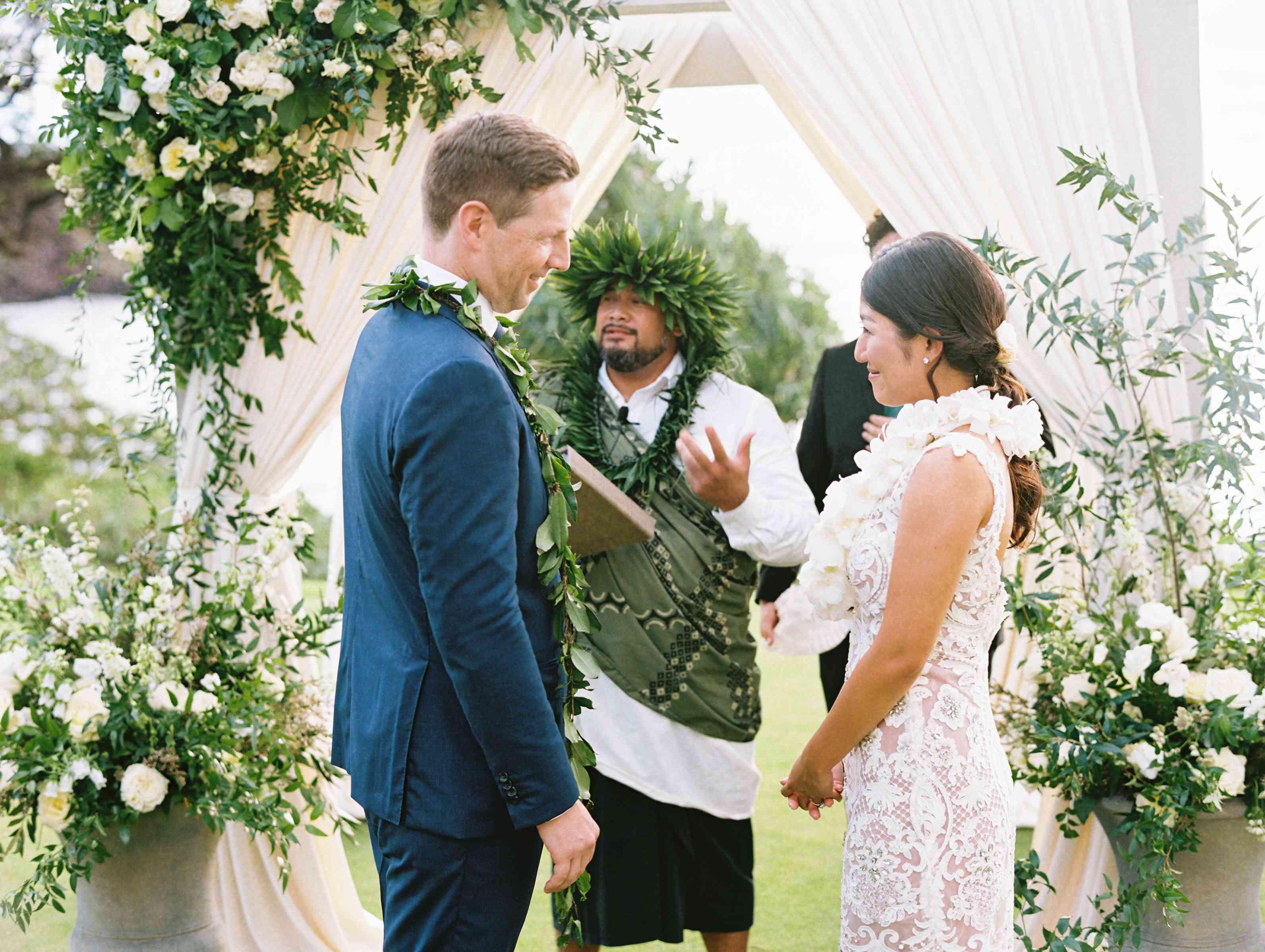 <p>couple at altar wedding ceremony</p>