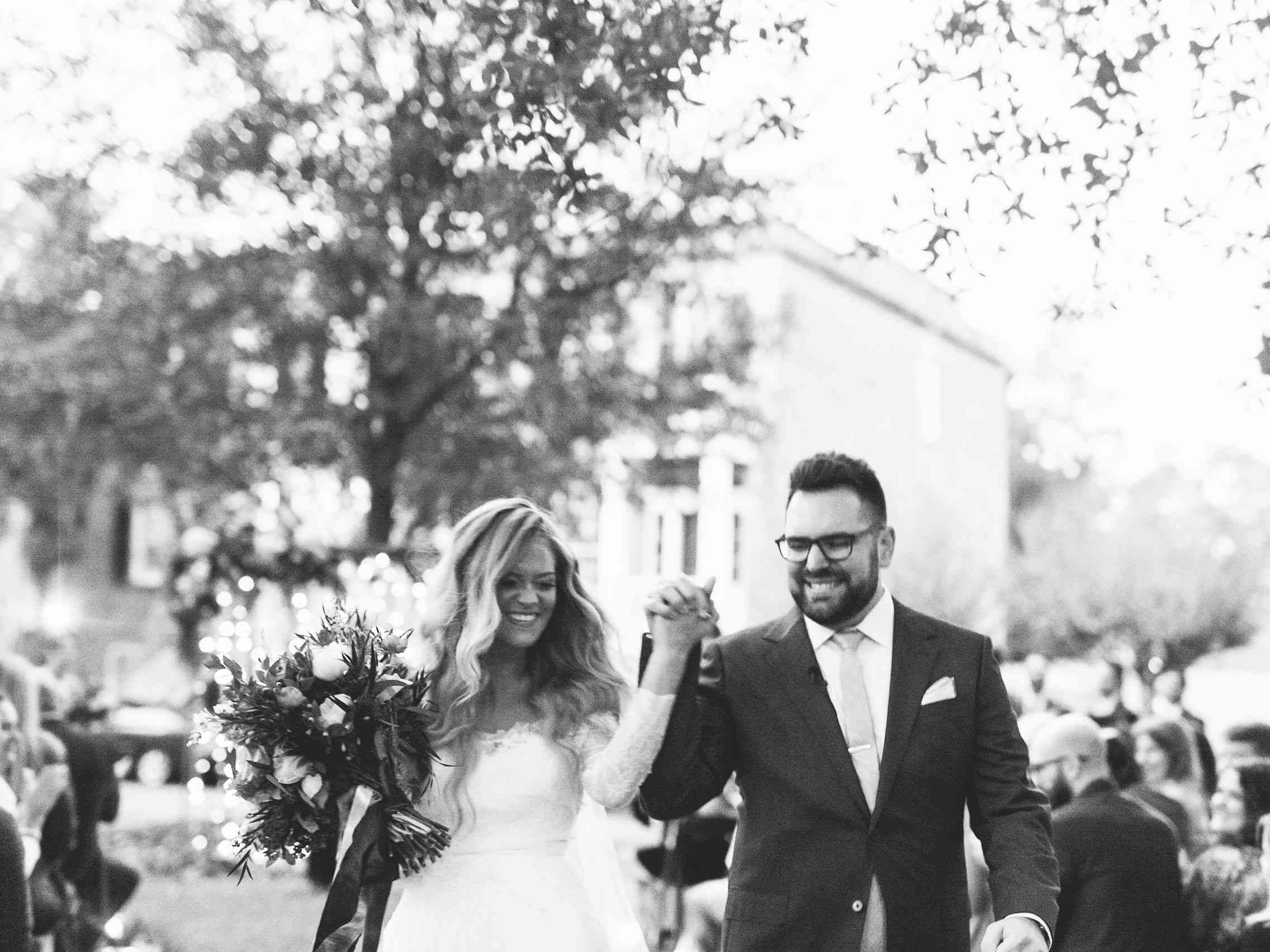 whimsical savannah wedding, bride and groom holding hands recessional