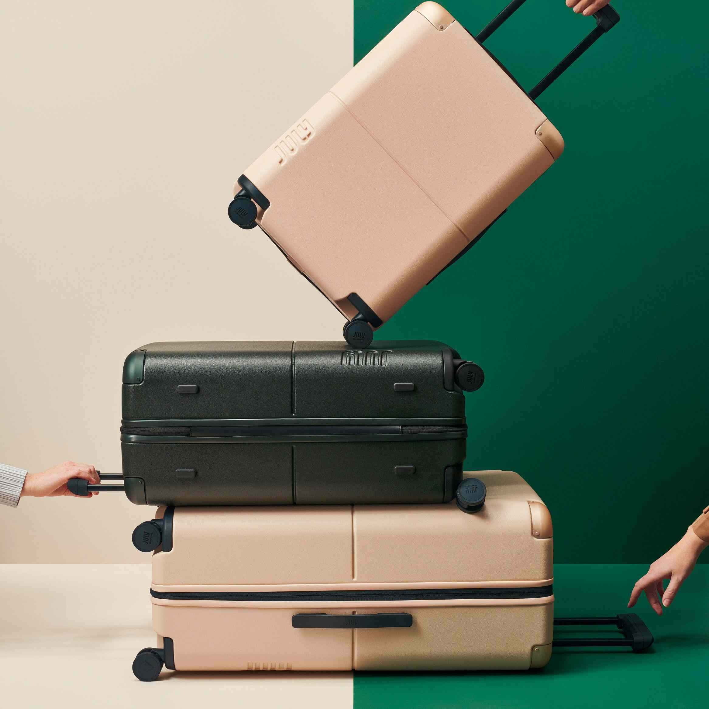 July luggage on green and beige background.