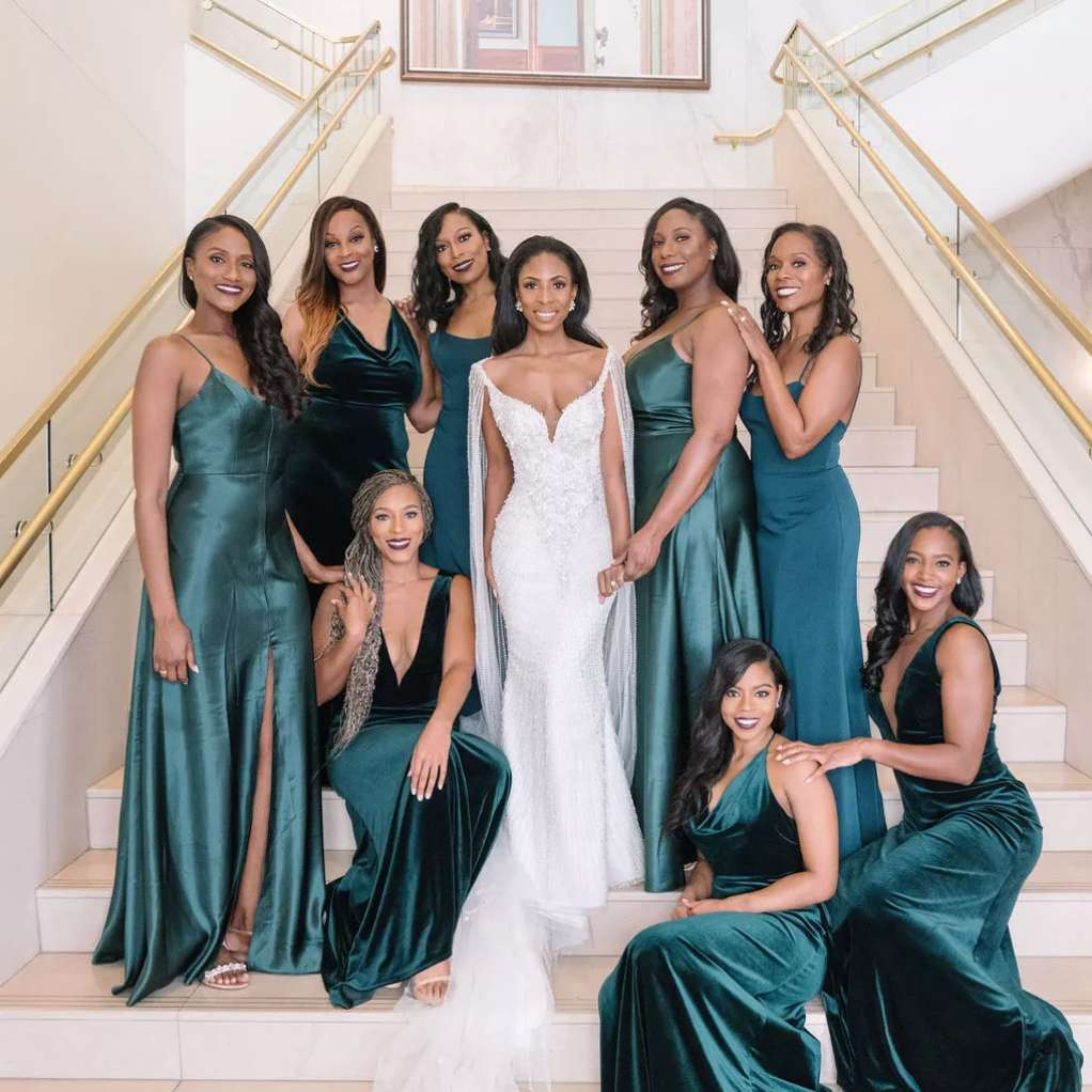 Bride with bridesmaids in emerald dresses