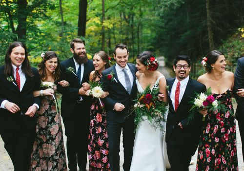 Bridesmaids and groomsmen with bride and groom