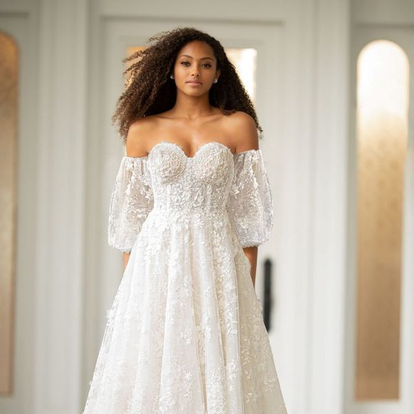 Model in lace off-the-shoulder gown with puff sleeves