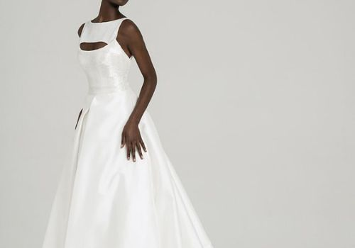 Model in high-neck ballgown with cutout
