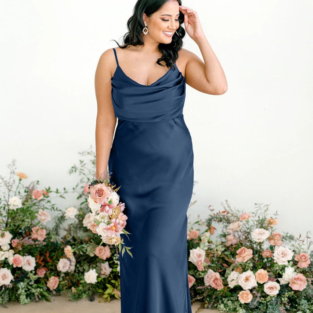 Model in a cowl neck satin blue floor-length gown