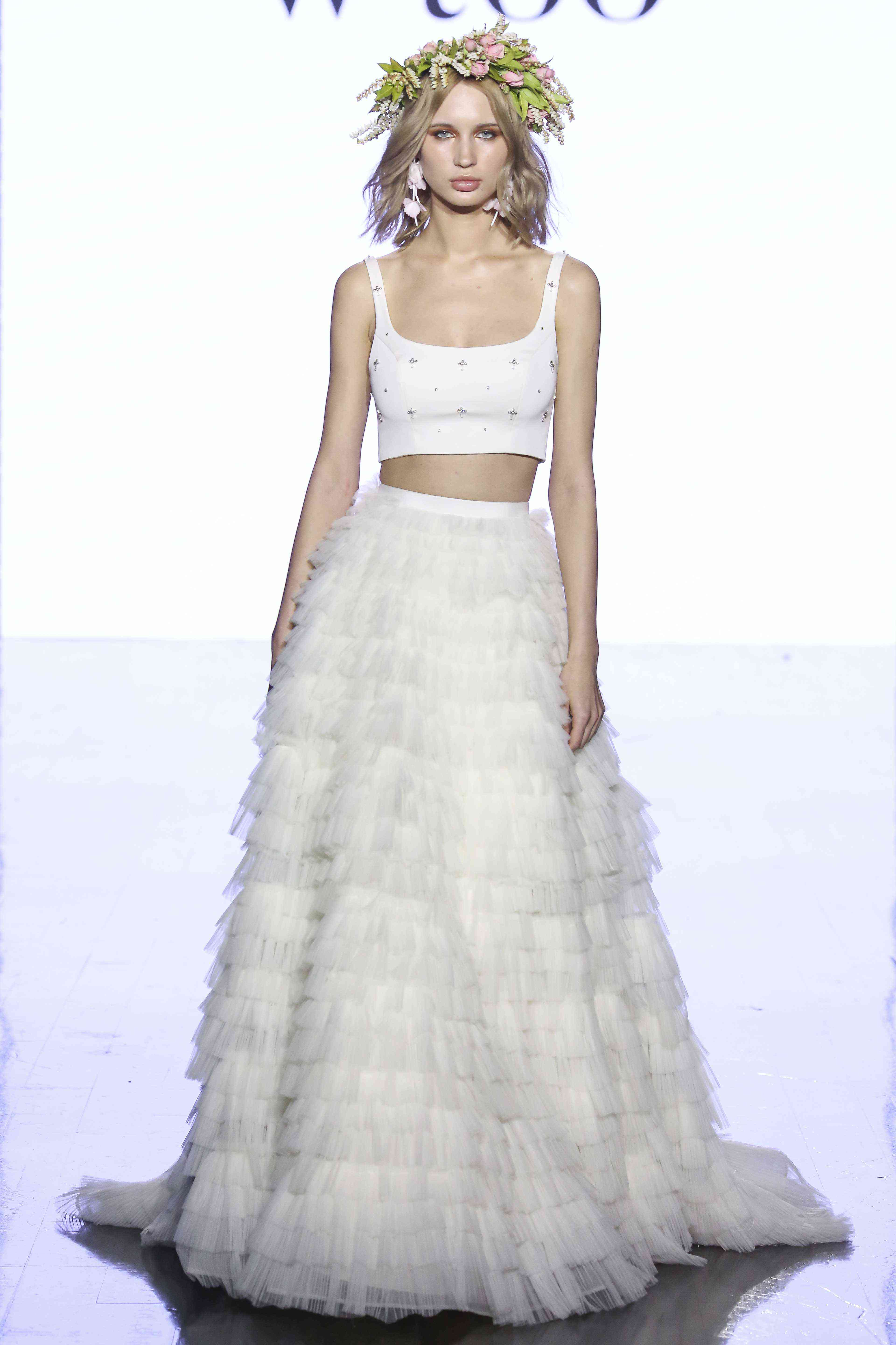 Model in beaded crop top with a layered tulle ball skirt