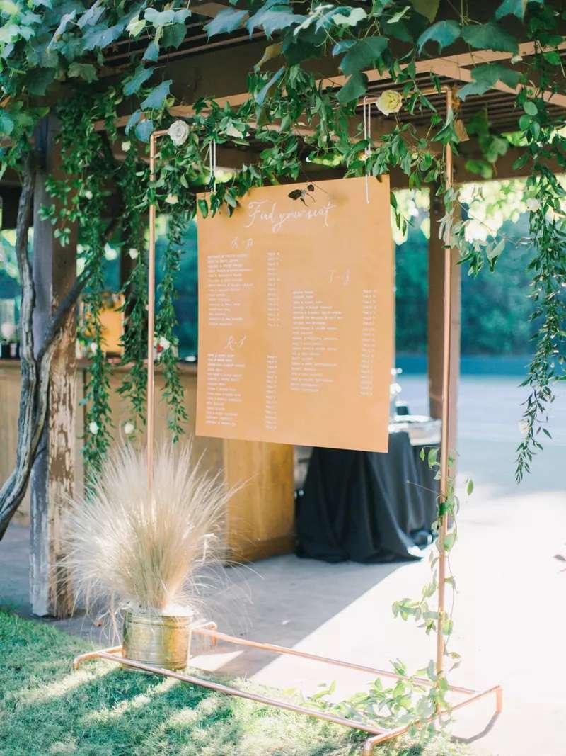 Wedding seating chart with greenery