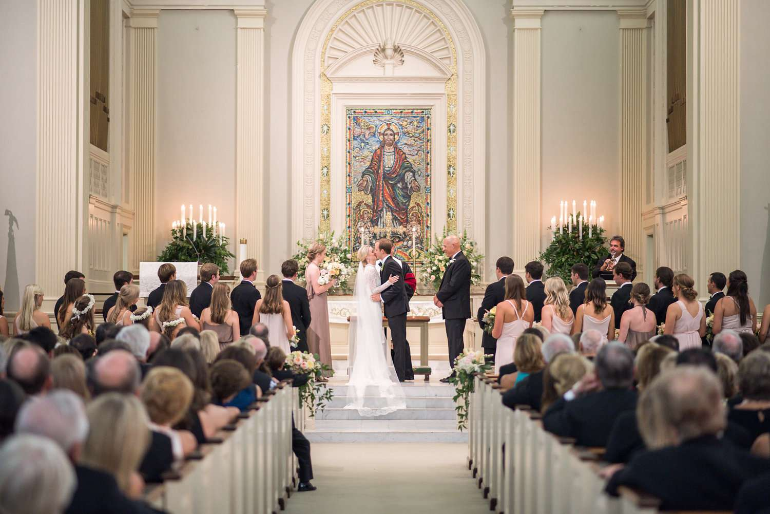 Couple kissing at church ceremony
