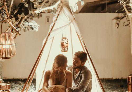 couple outside in a backyard tent
