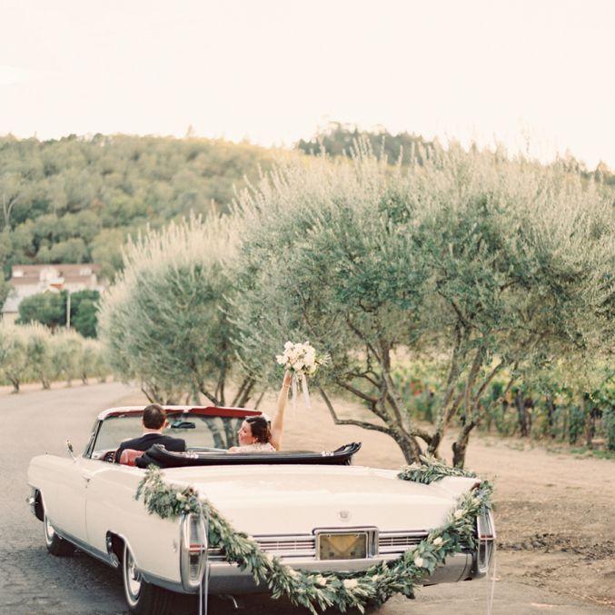 Wedding Getaway Car with Greenery Garland