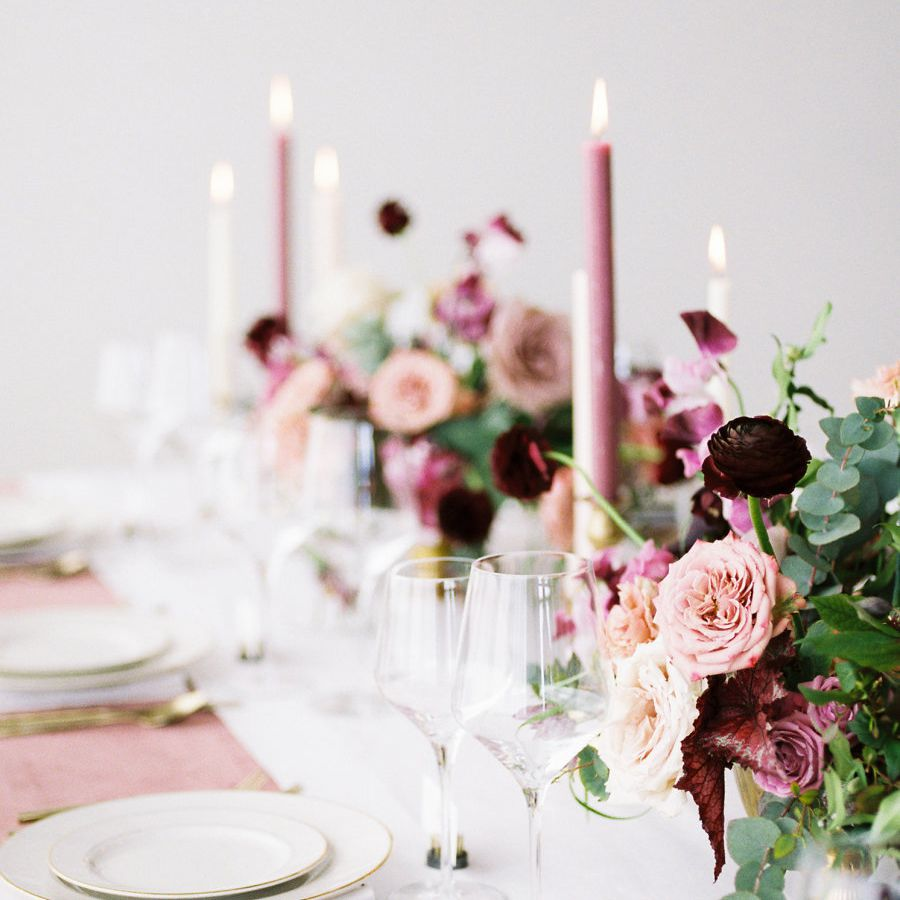 Dusty rose candles on tablescape