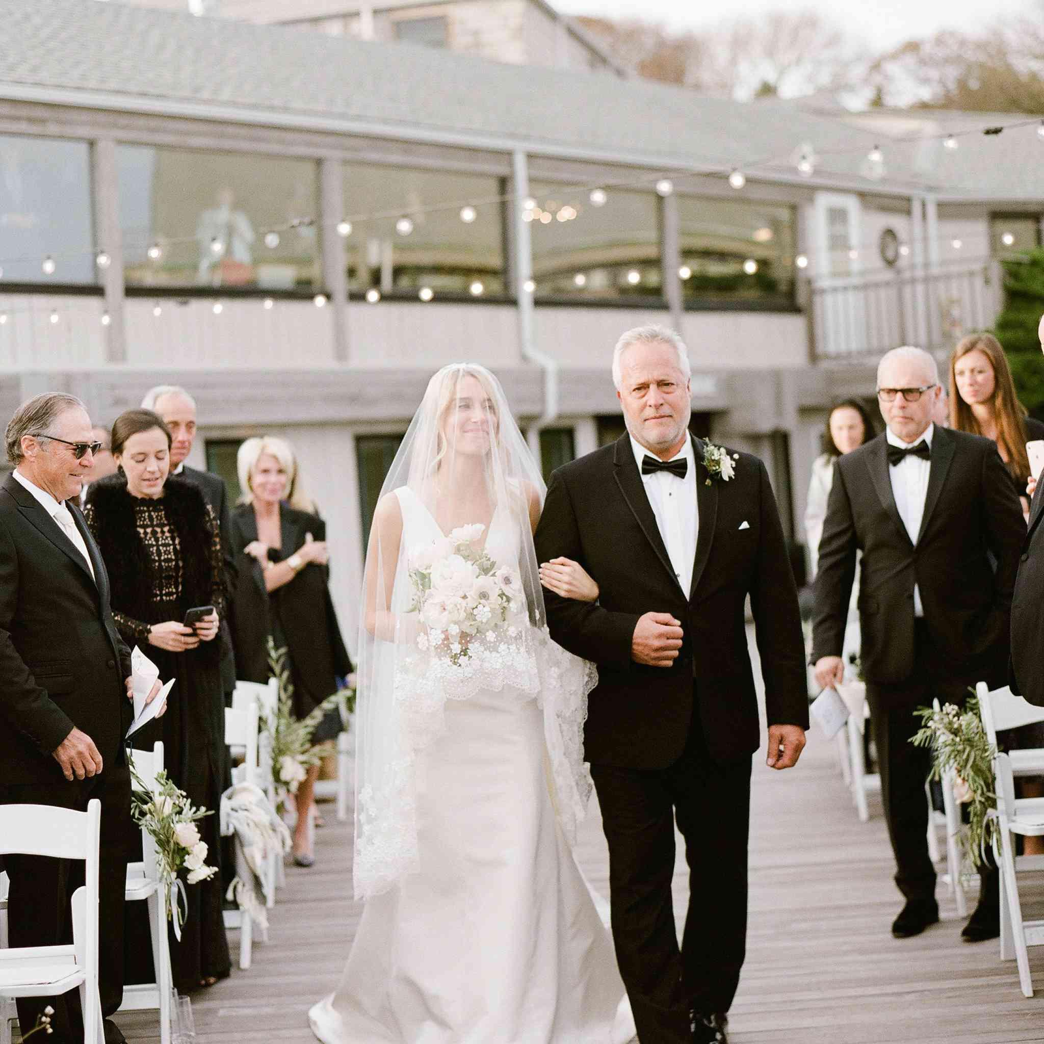 <p>father walking bride down aisle</p><br><br>