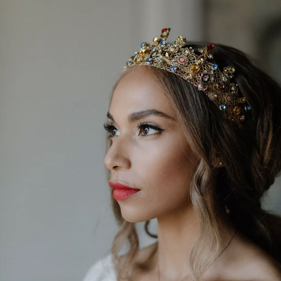 Bride wearing multi-colored crown