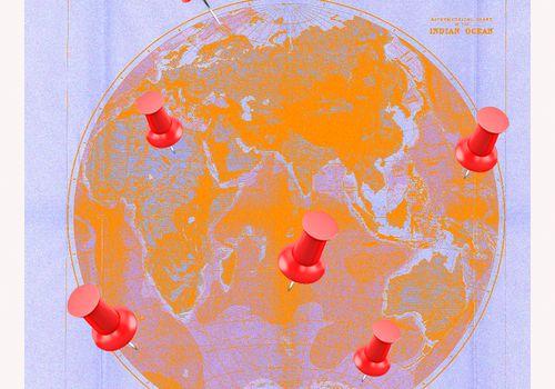 Thumbtacks on globe