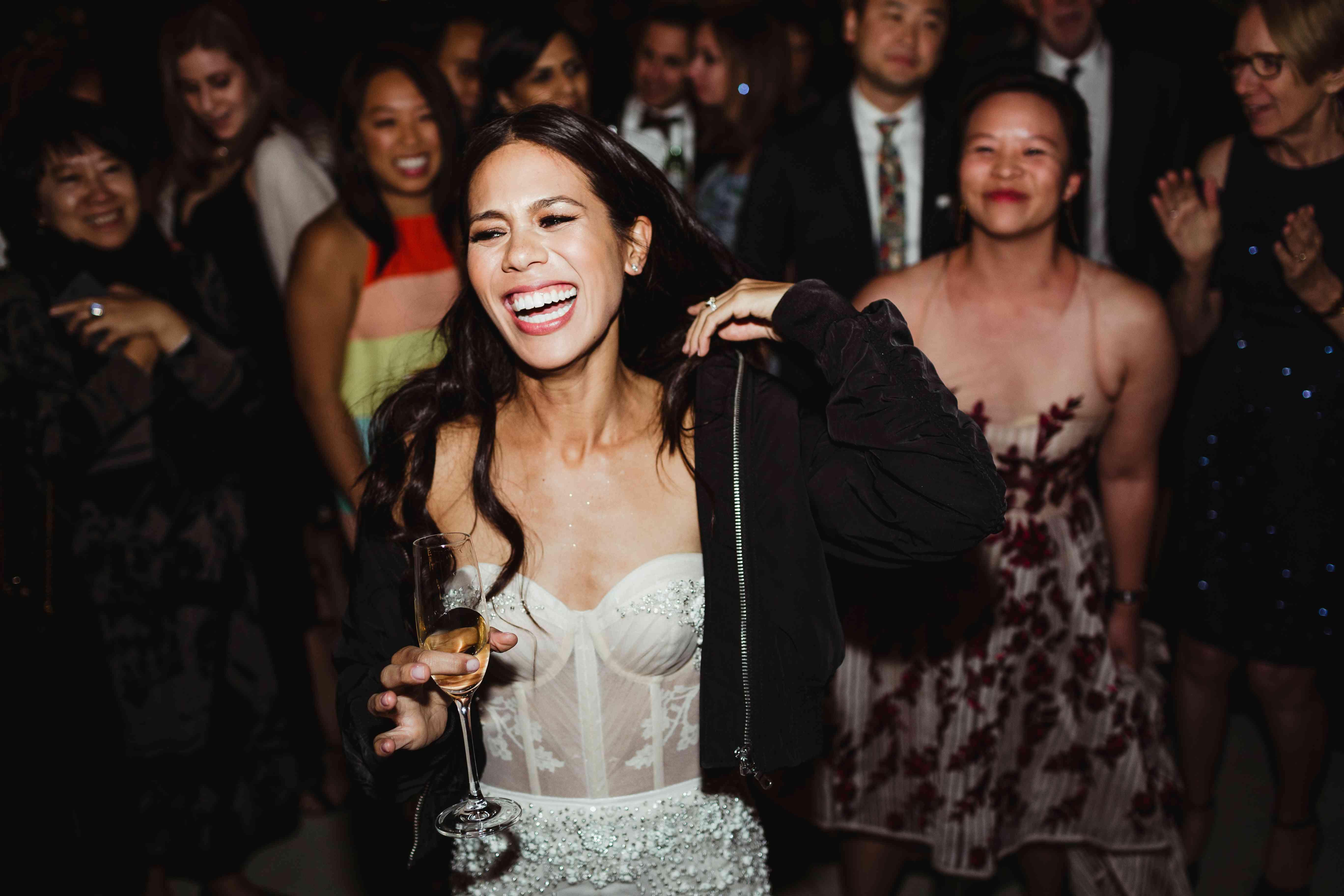 Bride in hoodie at wedding