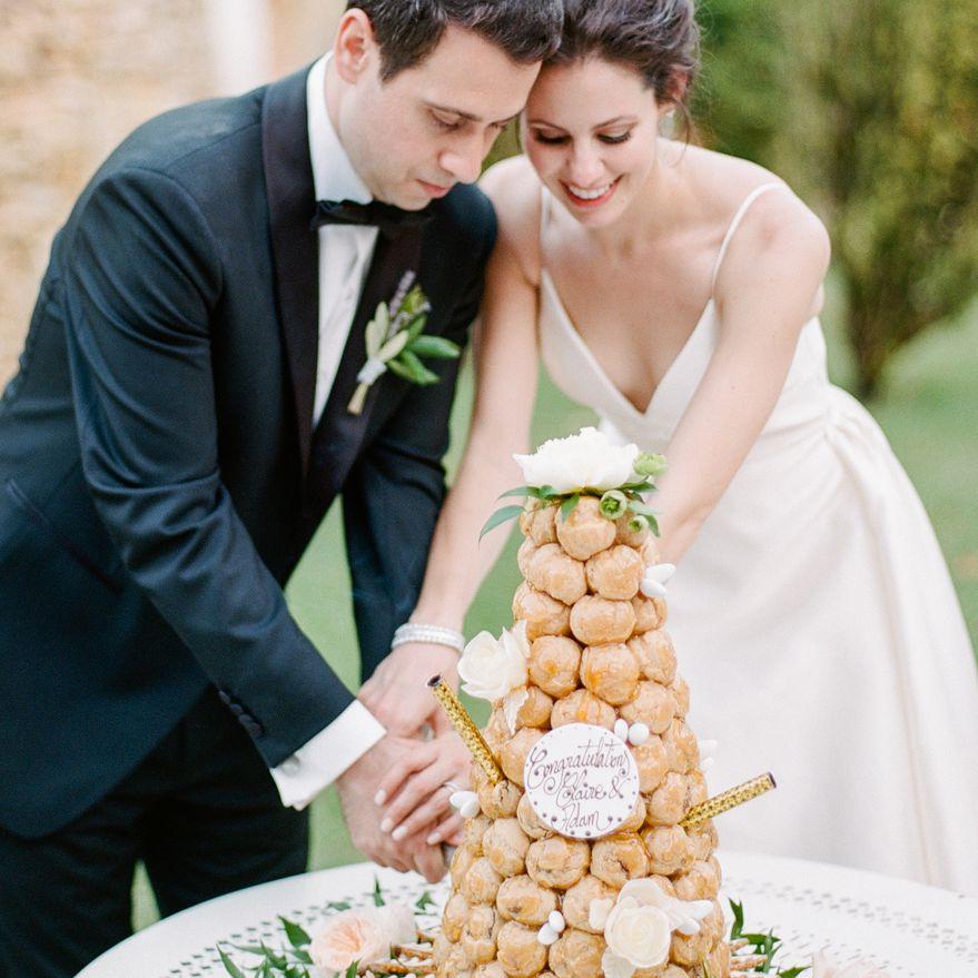 <p>cutting wedding cake croquembouche</p><br><br>