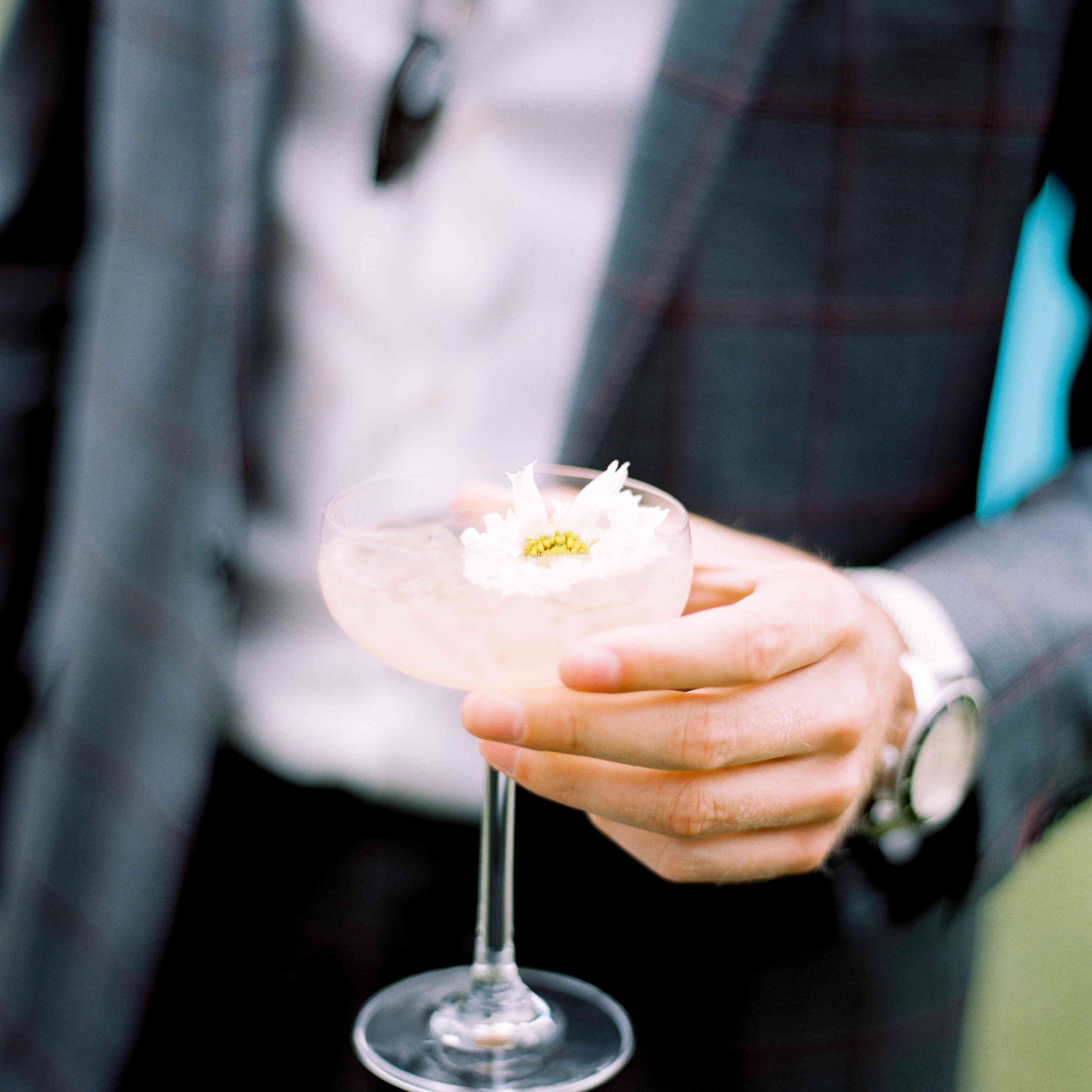 guest holding reception cocktail