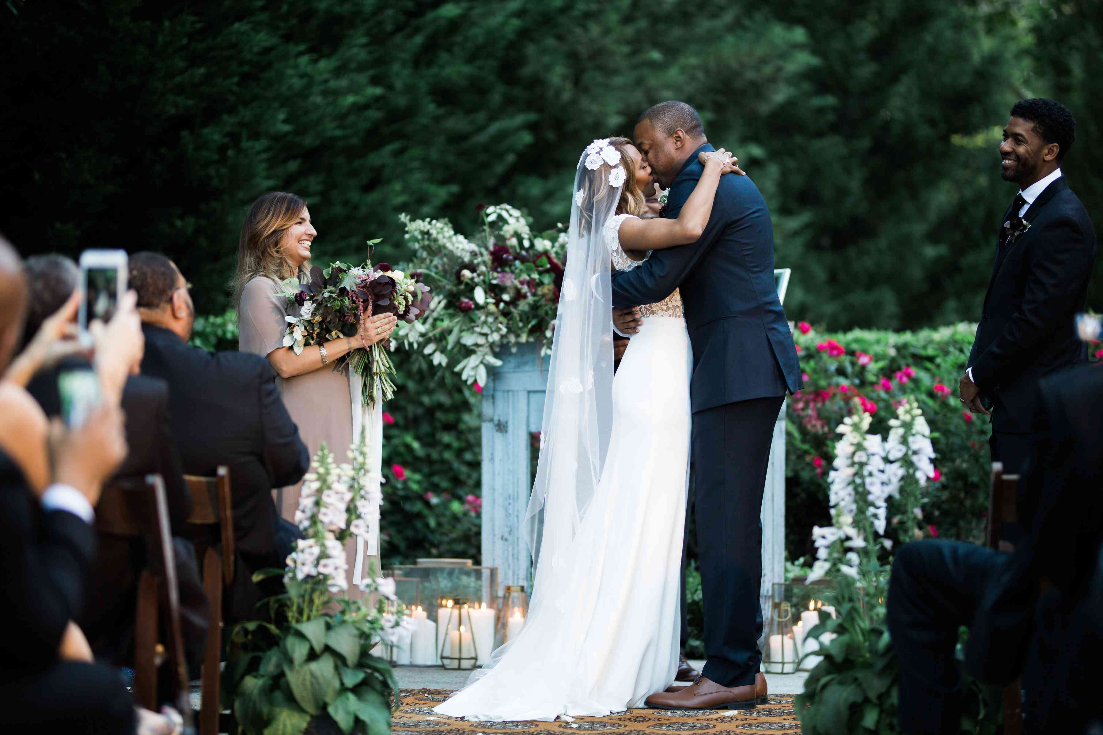 couple kissing during wedding ceremony