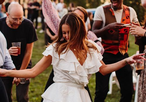Woman dancing with guests at a party