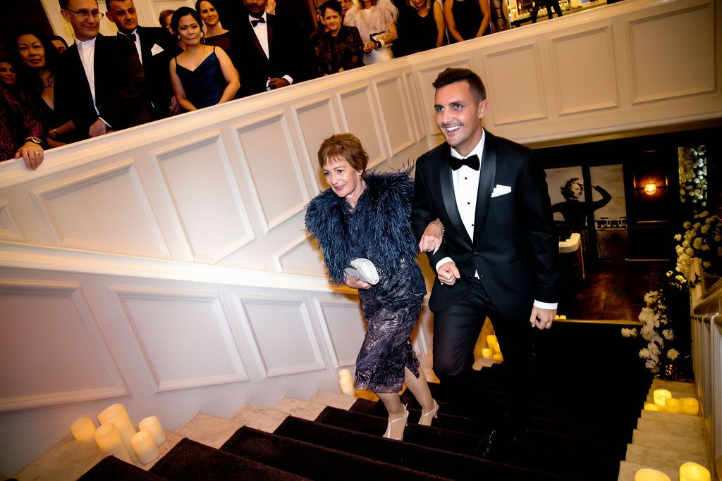 groom escorted by mother