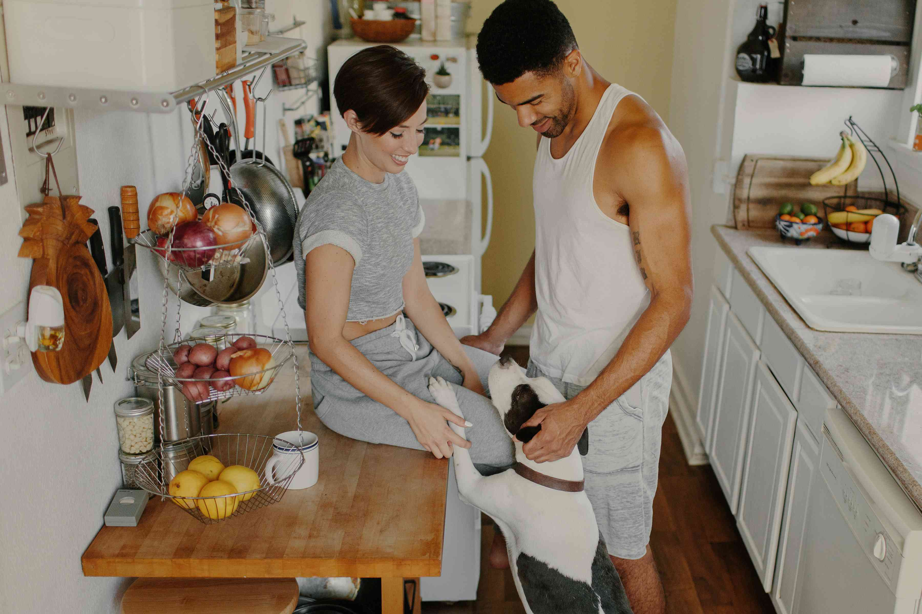 Couple in the kitchen with dog