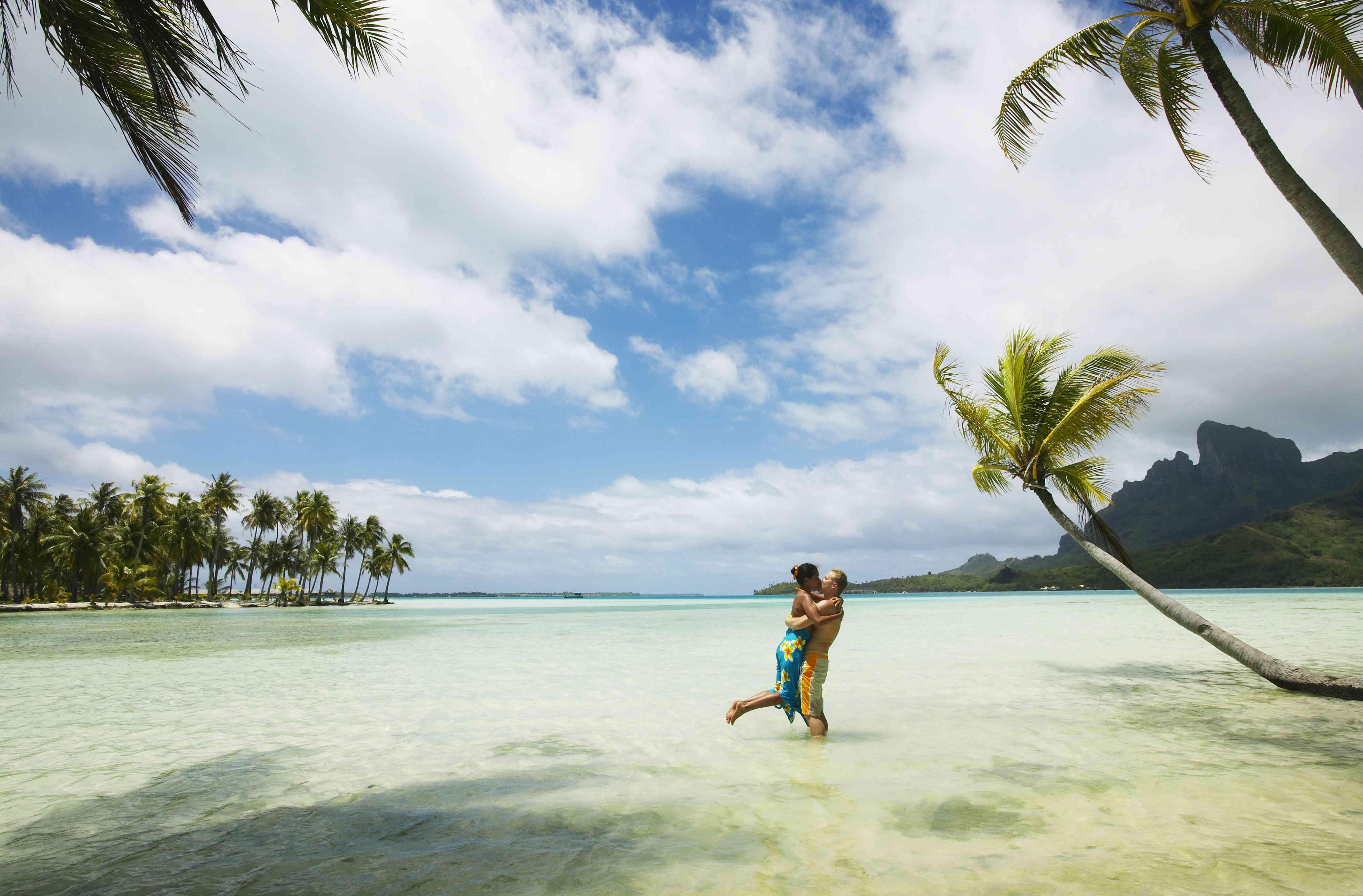 A couple kissing in Bora Bora, French Polynesia.