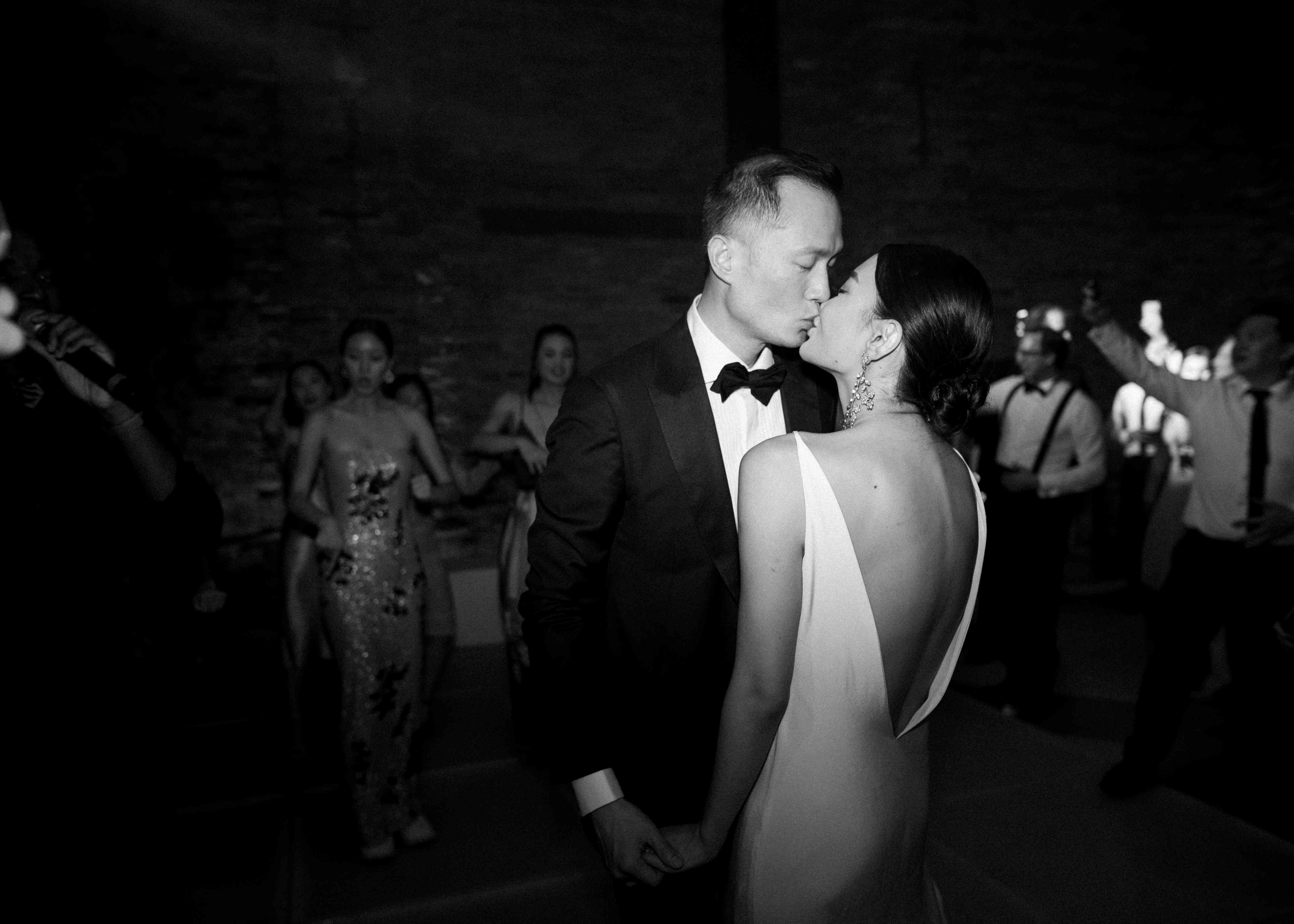 modern venice wedding, bride and groom kissing reception