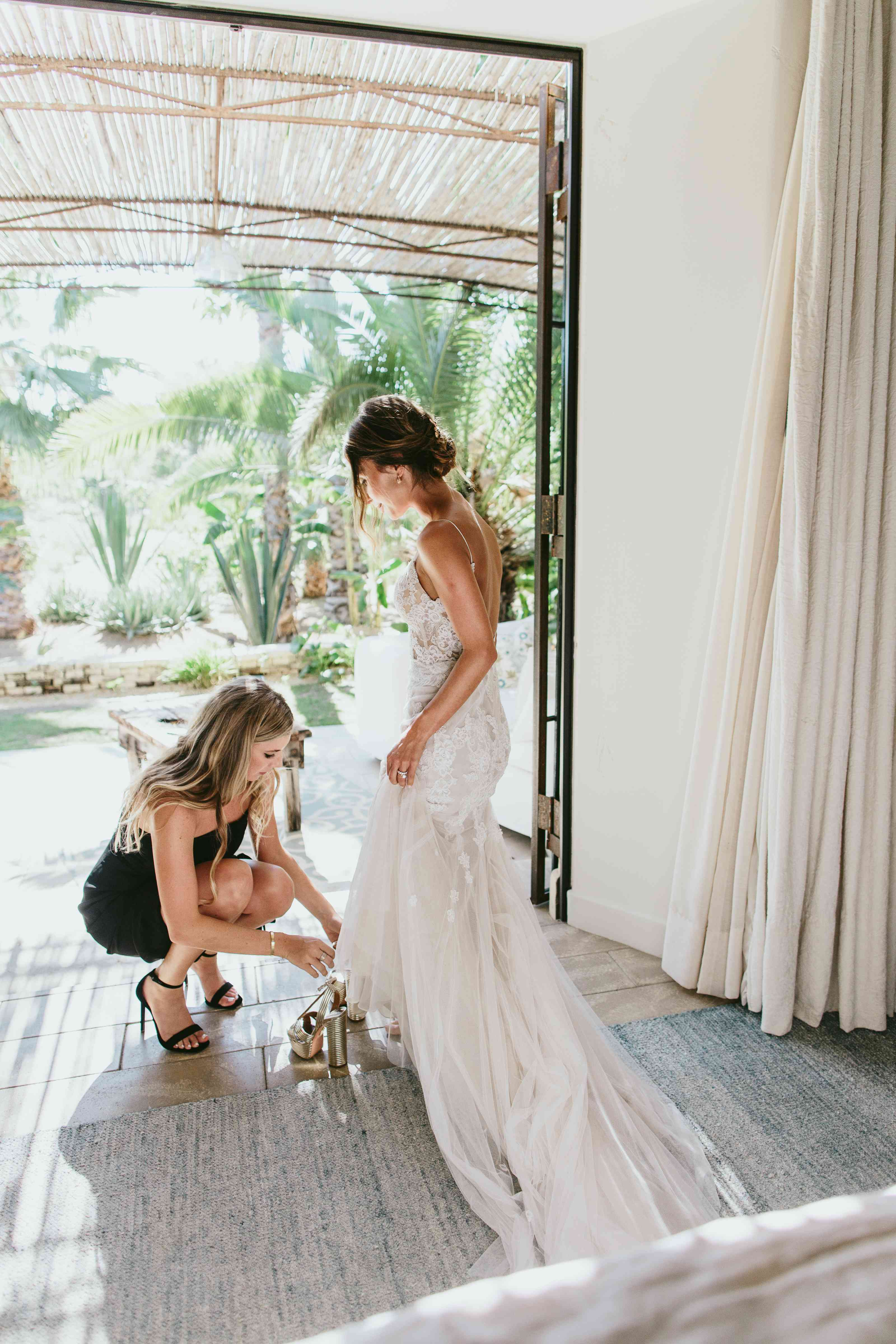 bride getting into shoes
