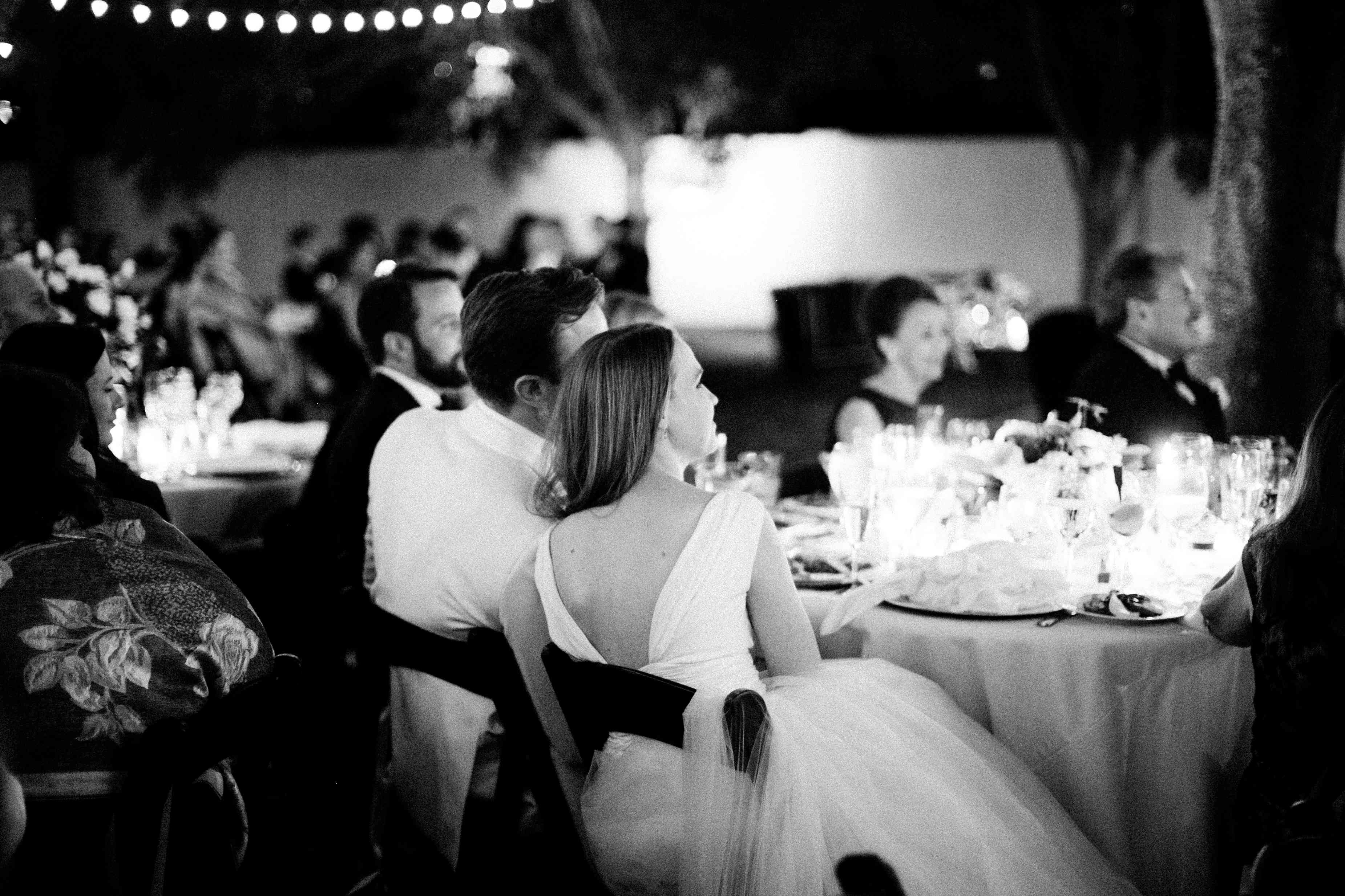Bride and groom during reception dinner