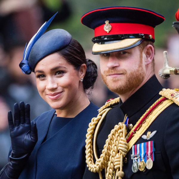 Prince Harry and Meghan Markle x ride by carriage down the Mall during Trooping The Colour, the Queen's annual birthday parade.