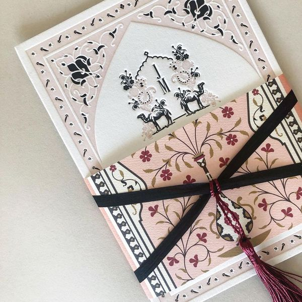 Pink floral invitation designed by Emily Baird.